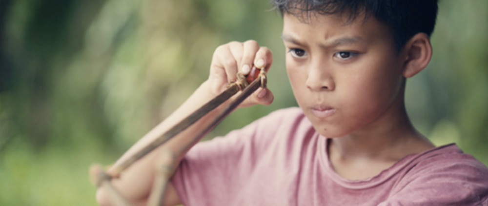 Abhilash Chandra / 2016 / Bahasa Malaysia / 18min   After discovering a strange man buried up to his neck in the ground, in the middle of a Malaysian palm oil plantation, Adi, a rebellious 10 year old Malay village boy, struggles to decide whether to save the buried stranger or not.