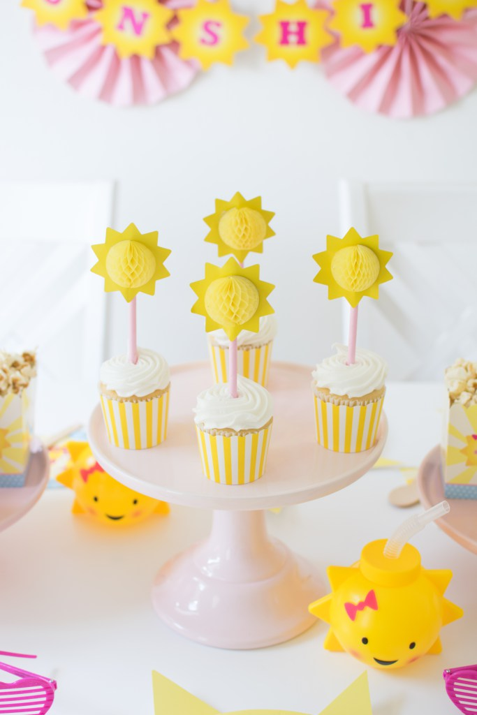 Must-Haves for celebrating summer in style with a 'You are my Sunshine' themed party - Add a fun surprise to the kids plates with DIY sunshine chargers. From Andressa of Twinkle Twinkle Little Party - as seen on www.FestiveFetti.com