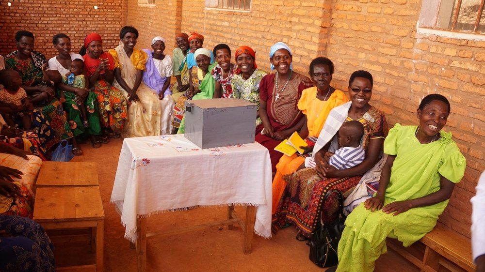 The weekly financial literacy meeting. - The box in front of the group is where they collect funds at each meeting. Photo: Burundi Friends International.