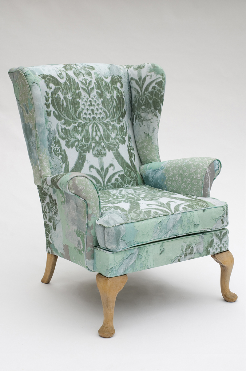 Parker Knoll 'Penshurst' chair upholstered in 'Peeling Paint' Green fabric  Photograph Marcos Bevilacqua
