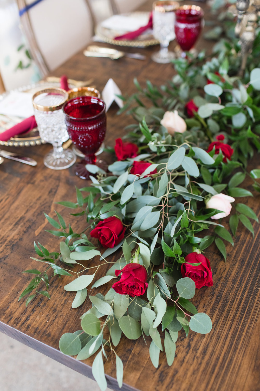 It wouldn't be a Beauty and the Beast Inspired editorial without heaps of lush roses. This gorgeous garland by A Wedding in Silk Floral Design incorporates Italian Ruscus, Eucalyptus, Sweet Olive, Buplurum and Roses.