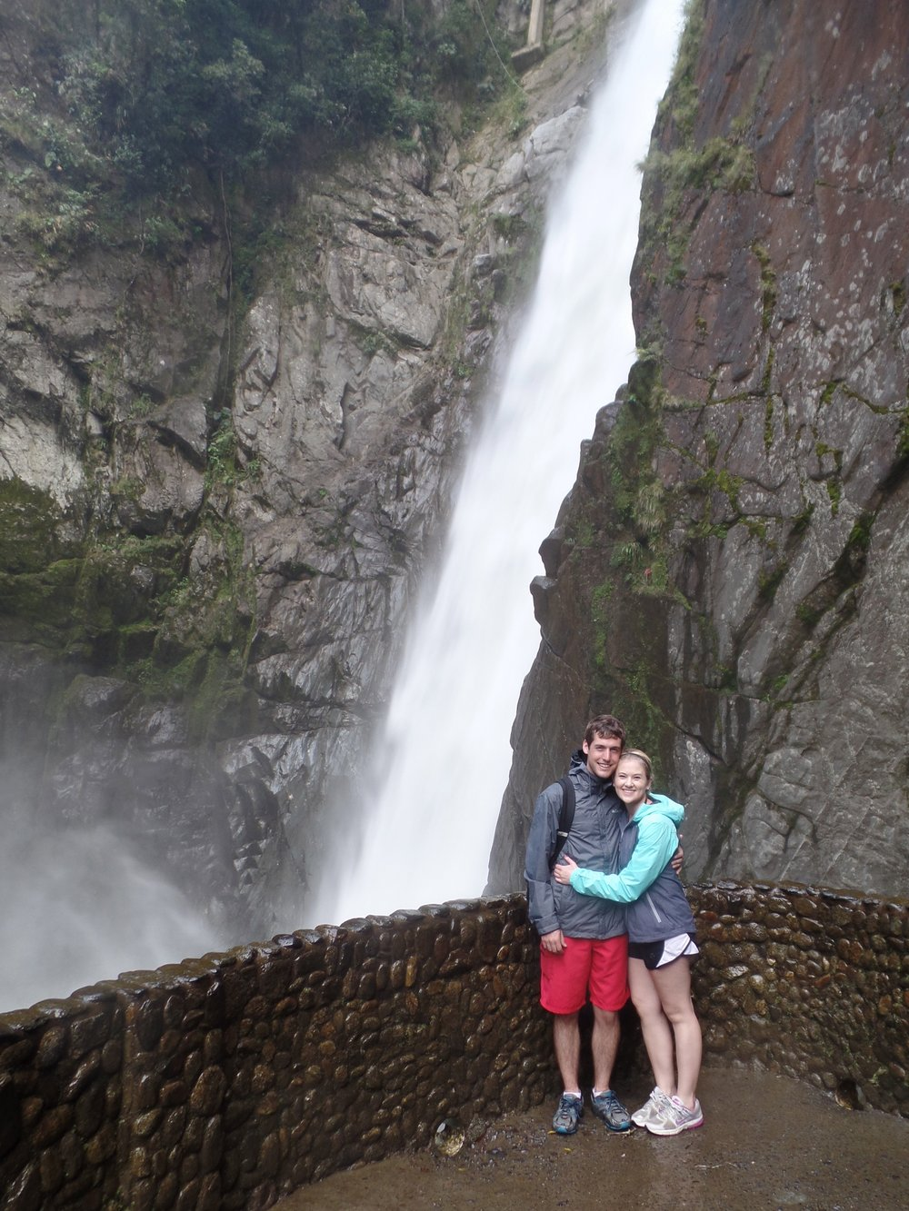 Kayla and Daniel McMullen in front of a waterfall