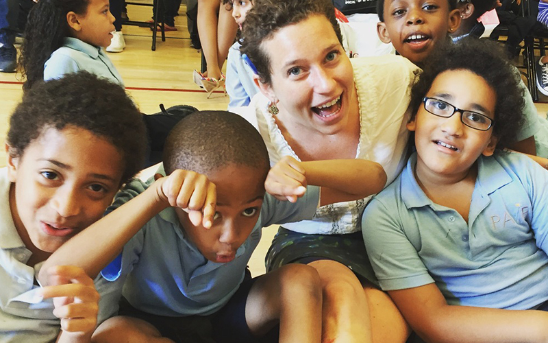 Ann Davis, founder of Venture with Impact, with her second graders in Brooklyn, NY