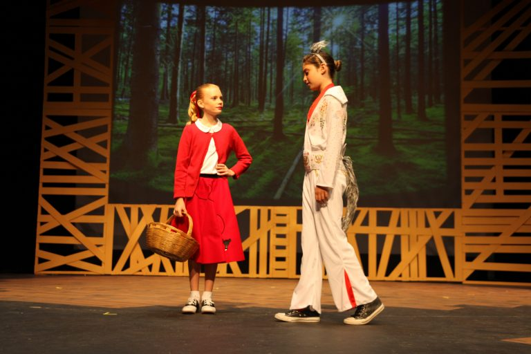 Claira Williams as Little Red Riding Hood and Zoe Zeichner as Big Bad Wolf, on stage at Lewis Auditorium at Flagler College. See performance information below. Photos by Renee Unsworth