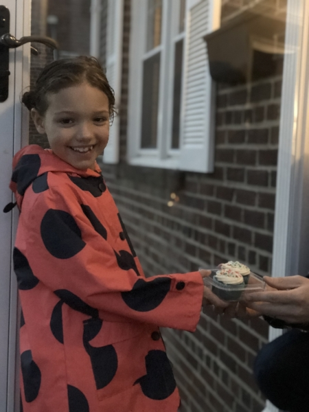 Charlotte, as she hand-delivers cupcake orders in her neighborhood