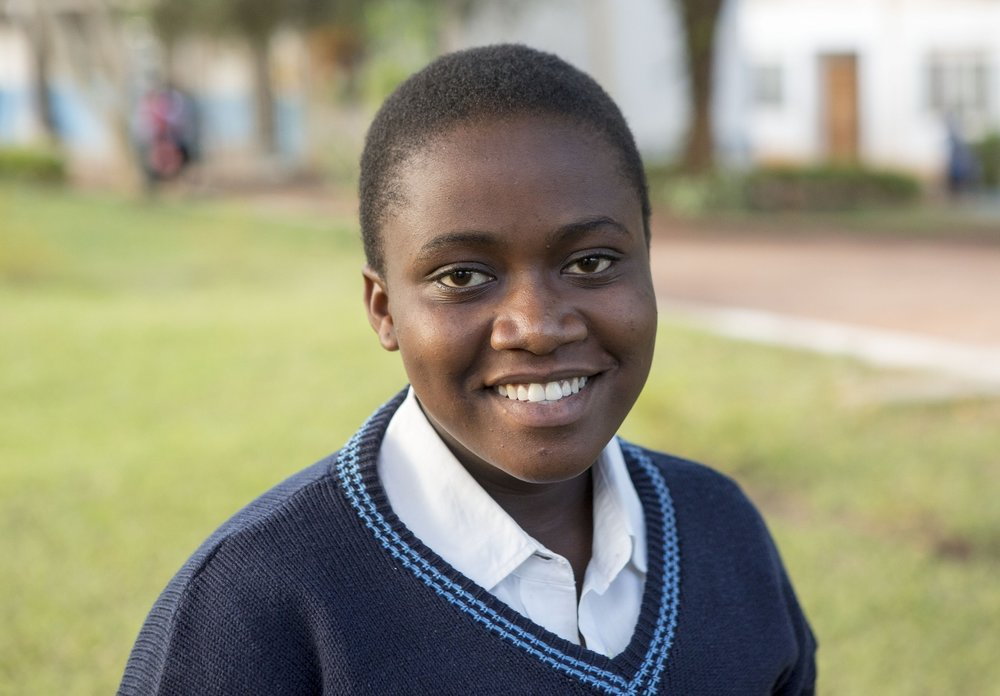 STF Scholar Susan is a Class of 2018 graduate this December! Not only does she tutor younger children in Uganda in her spare time, but she also volunteers at the local clinic.