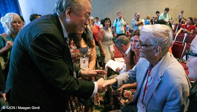 E.O. Wilson is greeted by the President of the IUCN, Mr. Zhang Xinsheng, in Honolulu, September 2016. Image courtesy of IUCN.