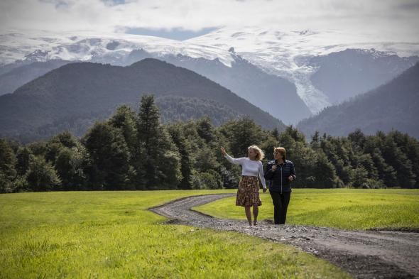 In a ceremony in Chile's Pumalín Park, American conservationist Kris Tompkins (left) and Chilean president Michelle Bachellet announced on the historic expansion of Chile's national parkland by 10 million acres. Photograph by Jimmy Chin.