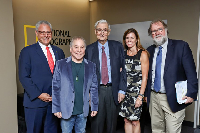 Speakers from the evening session of the planet's first-ever Half-Earth Day. National Geographic Society president and CEO Gary E. Knell (far left) stands with presenters (left to right) legendary recording artist Paul Simon, eminent biologist Edward O. Wilson, E.O. Wilson Biodiversity Foundation president and CEO Paula Ehrlich, and scientist, author, and educator Sean B. Carroll. The inaugural event was co-convened by National Geographic and the E. O. Wilson Biodiversity Foundation and held at the National Geographic Society in Washington, D.C. on Oct. 23, 2017. Photo by Tony Powell/National Geographic.