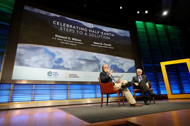 Scientist, author, and educator Sean B. Carroll (left) sits on stage with eminent biologist Edward O. Wilson (right) at the evening session of the planet's first-ever Half-Earth Day. The inaugural event was co-convened by National Geographic and the E. O. Wilson Biodiversity Foundation and held at the National Geographic Society in Washington, D.C. on Oct. 23, 2017. Photo by Tony Powell/National Geographic.