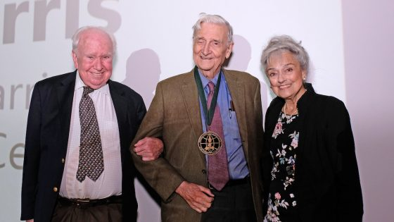 Peter Raven (left) and Anna Harris (right) stand with Edward O. Wilson after presenting him with the World Ecology Award.