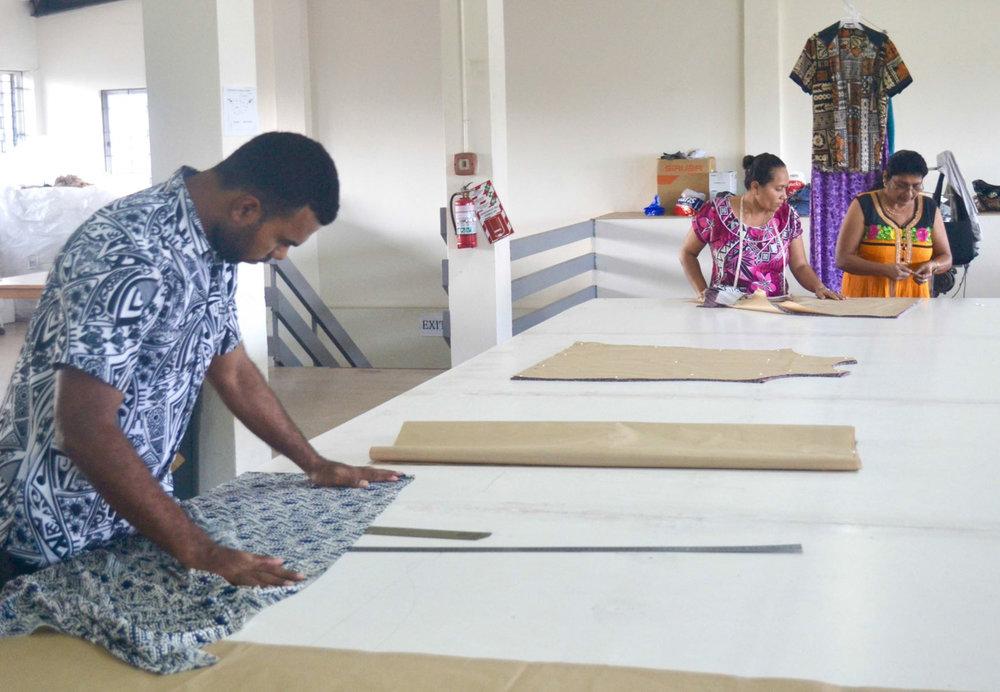 Malia Factory MAn on cutting table.jpg