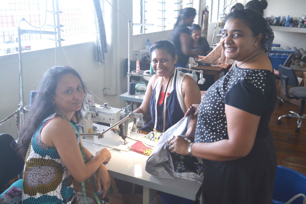 Malia Factory women at sewing machine.jpg