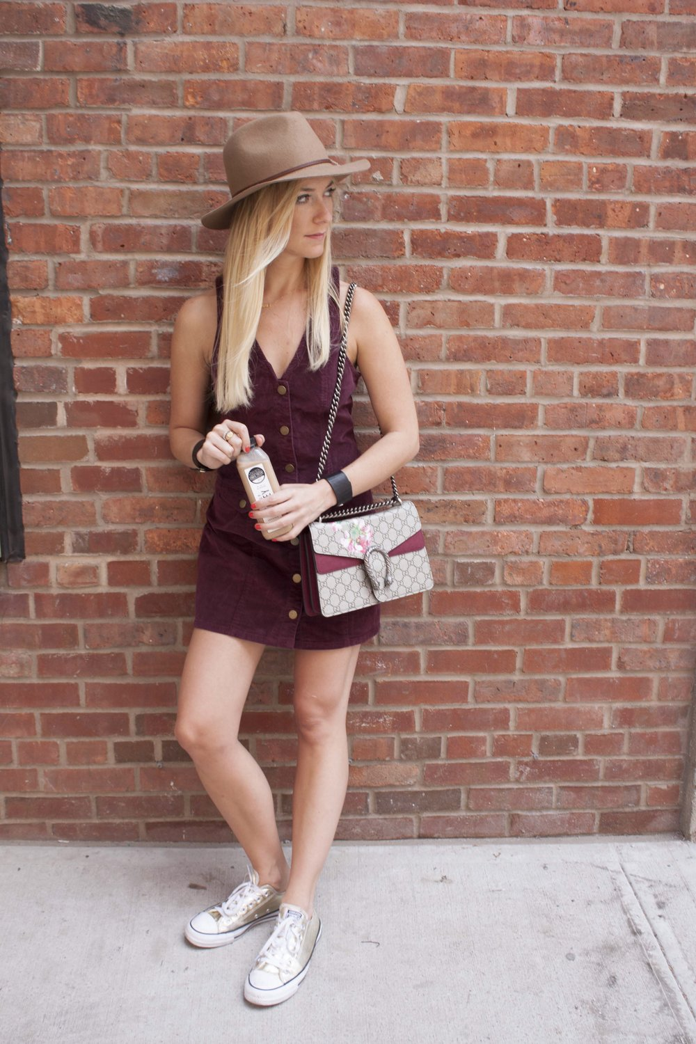 Dress: Urban Outfitters, Hat: Brixton, Bag: Gucci, Leather Wristcuffs: Rendor+Steel, Sneakers: Converse