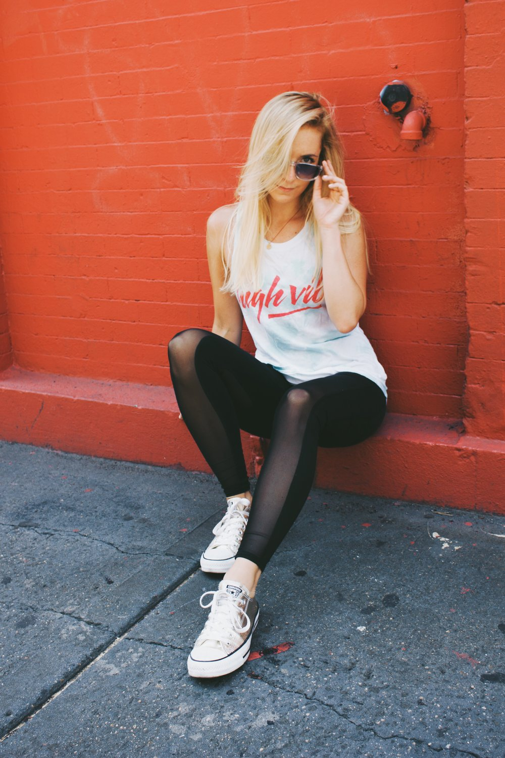 Top: Spiritual Gangster, Leggings: Alo Yoga, Sneakers: Converse, Sunglasses: Selima Optique