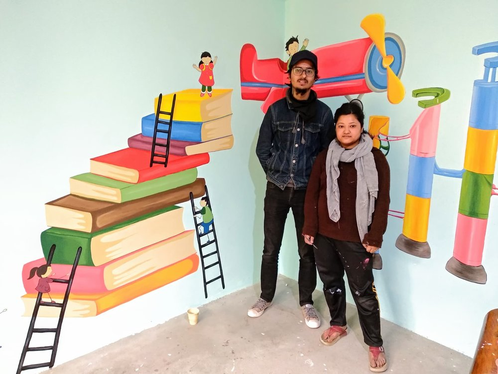 Sarala Manandhar - Assisted by Assis Koirala Visual artist and illustraterSarala and Assis made a beautiful mural at one of the classrooms off Baby Life home for us in 2018.