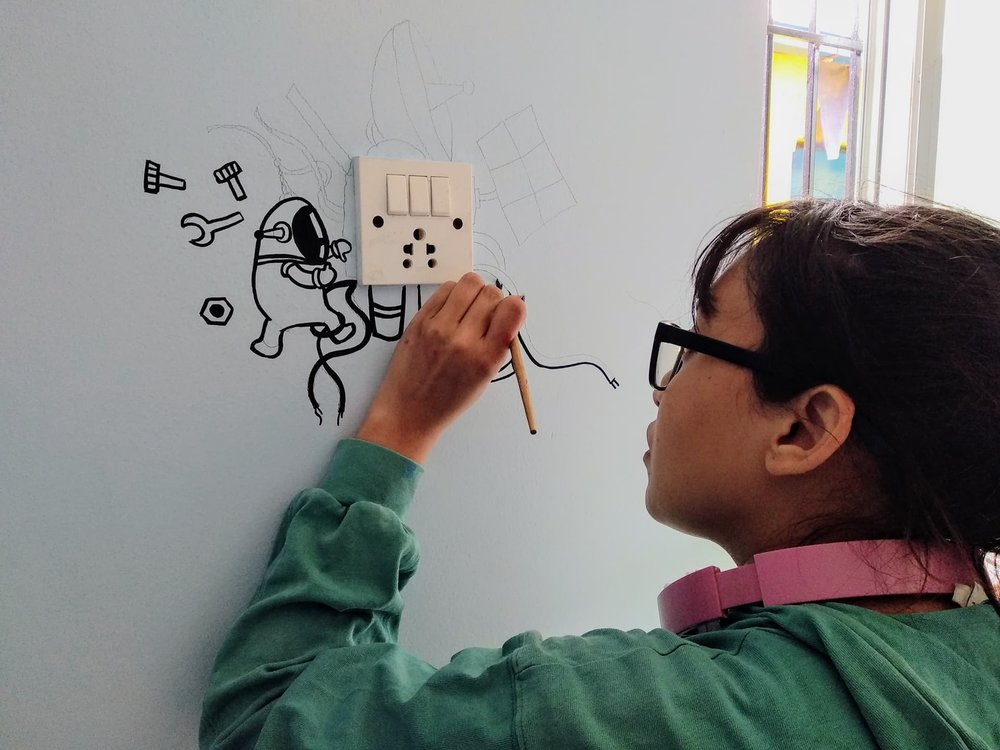 Mrigaja Bajracharya - Visual artist and illustraterMrigaja made a amazing mural in one of the class rooms off Baby Life Home for us in 2018.