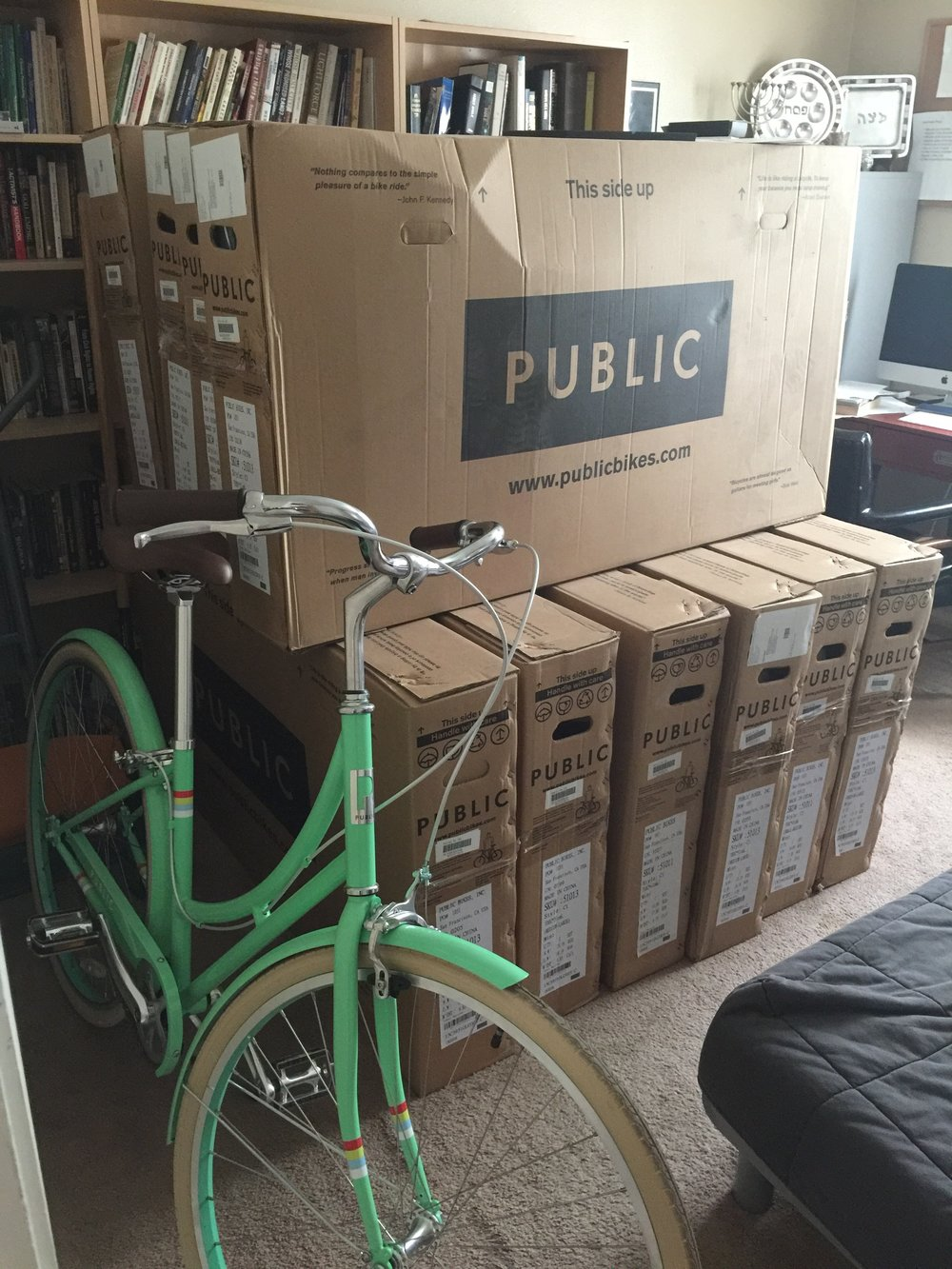 When I conceived of Flambeaux Bicycle Tours I bought a fleet of 11 mint colored PUBLIC Bikes. They're currently sitting in my office. For every $2,000 that we raise, I am going to take a bicycle out of the box and put it together. Be a part of this exciting  campaign  to get them out of my house and into a storefront!