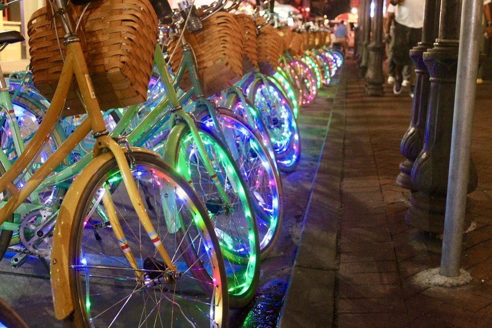 Night bike ride with glowing wheels in Nola.