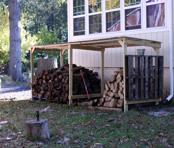 simple woodshed with pallet sides