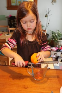 child shaving orange peel