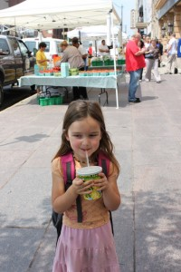 child enjoying lemonade at pearl alley
