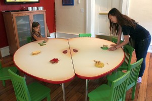 playing games around apple shaped table