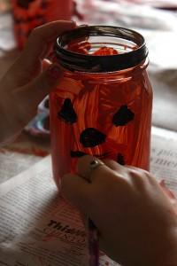 making faces on jar jack-o-lanterns