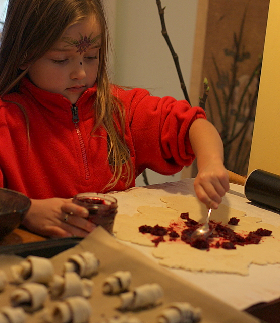 child spreading jam for rugelach