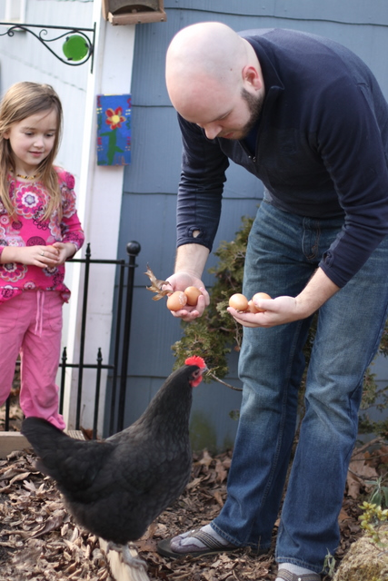 family with their backyard chicken