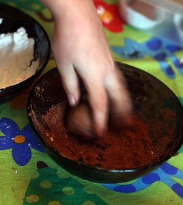 rolling truffles in cocoa powder