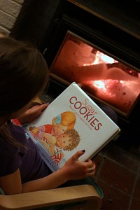 reading sugar cookies book by the fire