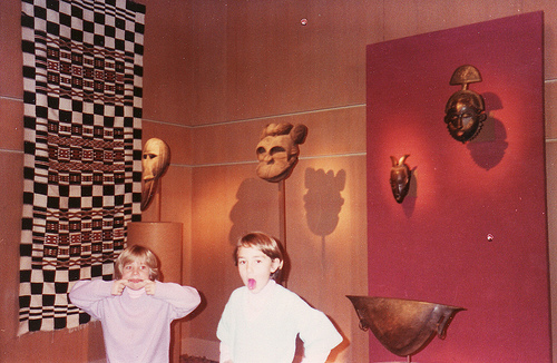 kids making faces at museum