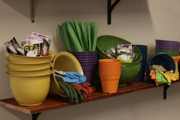 colorful pots and gloves at city folk's farm shop