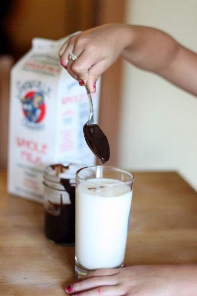 dropping homemade chocolate into snowville milk