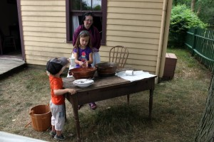 washing dishes in outdoor kitchen