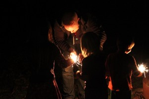 adult lighting sparklers with kids