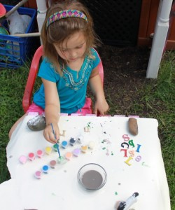child painting wooden letters