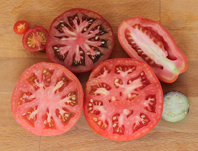 seven heirloom tomatos cut open