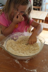 child mixing dough