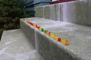 gummy bears lined up on the sidewalk