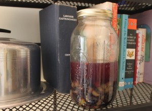 liqueur resting on cookbook shelf