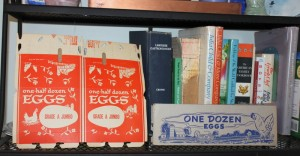 vintage egg cartons on book shelf