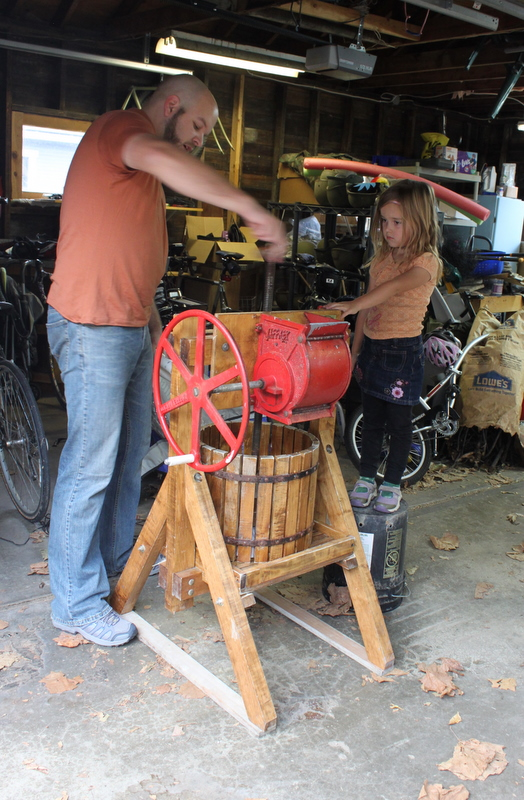 working a hand crank cider press