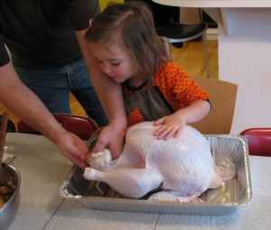 child helping to cook a turkey