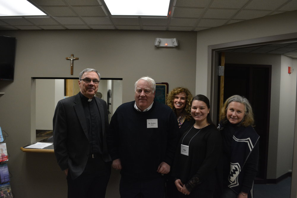 Father Neal Quartier, Dr. David Dasher, Kathleen Komar, Olga Kondrya and Dr. Lynn Satterly