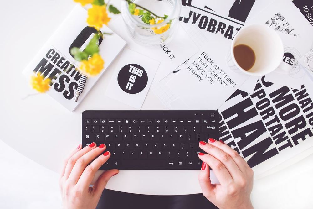 kaboompics.com_Girl-writing-on-a-black-keyboard-Copier.jpg