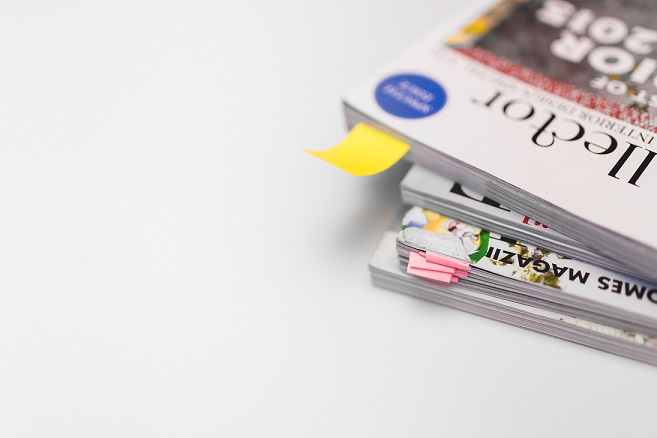 kaboompics.com_Stack-of-white-magazines-with-copy-space.jpg