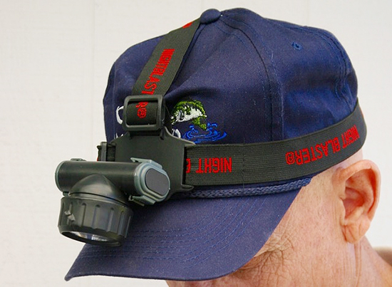 A light that straps to your head or attaches to your cap is handy at night.