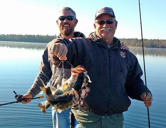 Clark Reehm and Albert Collins show off an A-Rig double from an East Texas lake.